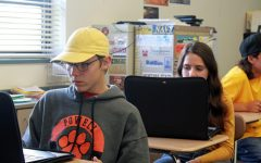 Powell High School sophomores Ben Hawley and Kameron French work on their Lenovos before the closure of schools.