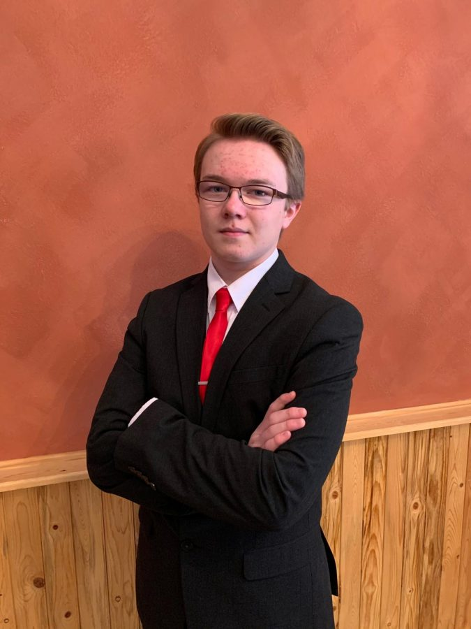 Sophomore Aiden Chandler poses for a photo he submitted to participate in the National Speech and Debate tournament.