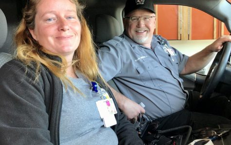 Emergency Medical Technician (EMT) Jennifer Yourk and Registered Nurse (RN) Scott Bagnell roll out of the garage in one of Powell Valley Healthcare's ambulances after being dispatched to an emergency.