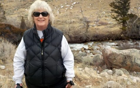 Mrs. Katherine Ackley poses for a picture during a hike.