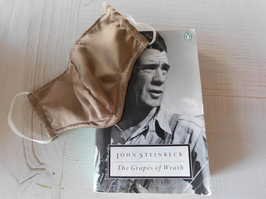 "John Steinbeck's ""Grapes of Wrath,"" a novel about the Great Depression, with a face mask worn to prevent the spread of COVID-19."