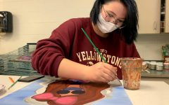 PHS senior Dylan Croft works on her painting during art class. Croft moved from Gillette to Powell this year.