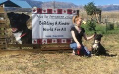 Pitbull Corgi candidate Prez posing with Prowl reporter Lucyjane Crimm in front of his campaign poster