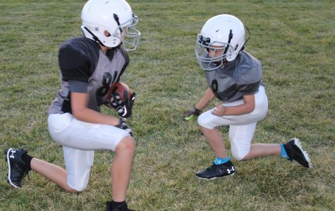 The Powell Raiders practice tackling in their last practice of the season.