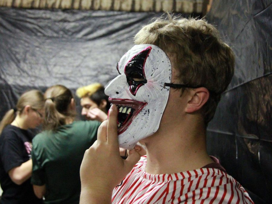 PHS senior CJ Brown puts on a mask during last year's haunted house.