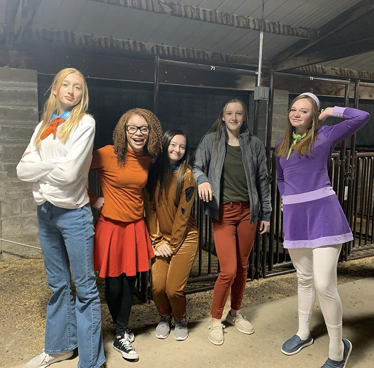 (From left) Freshmen Addy Thorington, Amiya DeFoeLove, Stevee Walsh, Waycee Harvey and Gracie Wolff show off their Halloween costumes at the haunted house