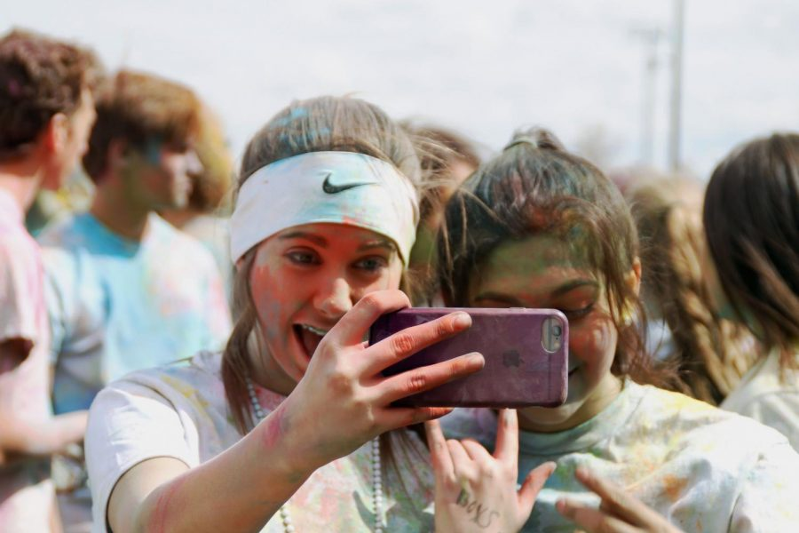 PHS juniors Kameron French and Lorena Vazquez pose for a selfie after the 2019 PHS Color Run.
