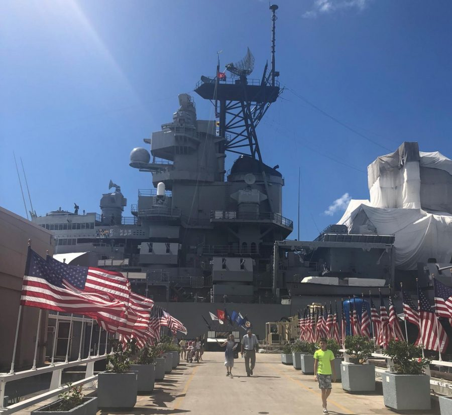 Flags line the cement walkway that leads to the retired battleship, U.S.S. Missouri.