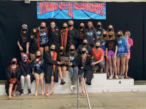The Lady Panther swimming and diving team poses on on the podium with their third-place 3A state plaque Saturday in Laramie. The four seniors -- Elizabeth Liggett, Emma Karhu, Madison Lowery and Addy Moretti - are pictured center front, starting fourth from left.