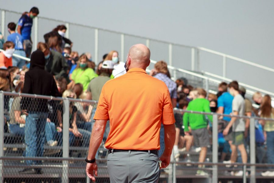 Powell+High+School+Principal+Mr.+Tim+Wormald+walks+past+students+gathering+on+the+bleachers+for+an+assembly.+