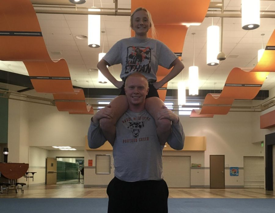 Senior Geordan Weimer supports junior Morgan Schmidt during a Panther cheer practice.