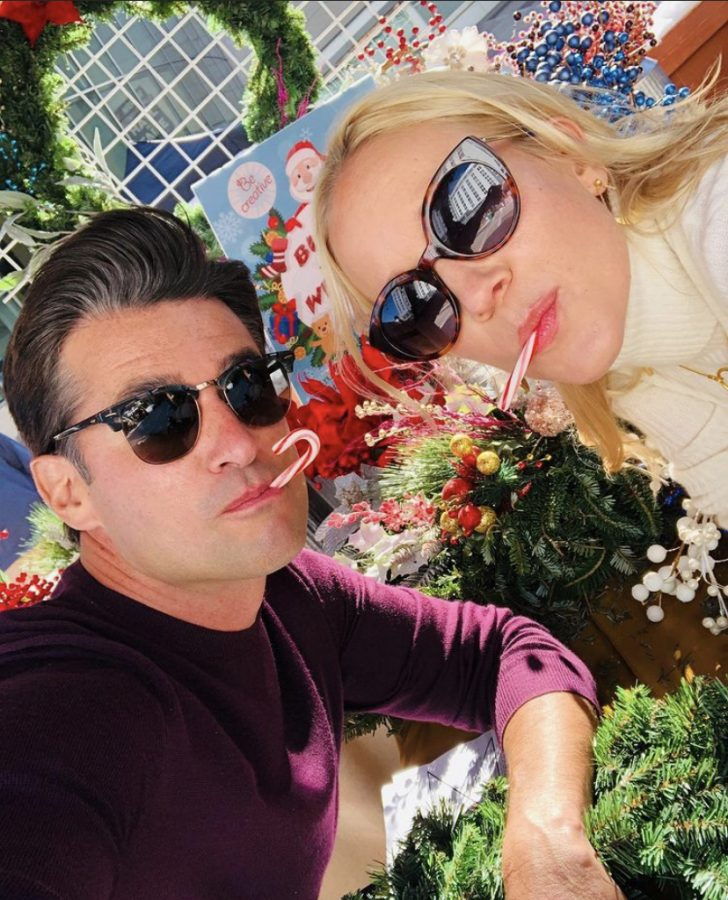 """Hallmark actor Wes Brown and actress Jessy Schram eat candy canes and wear sunglasses while posing for a photo on September 22. The photo was captioned """"Movie. Music. Candy canes (minus two) coming soon,"""" and the newest movie featuring the two actors came out last month."""