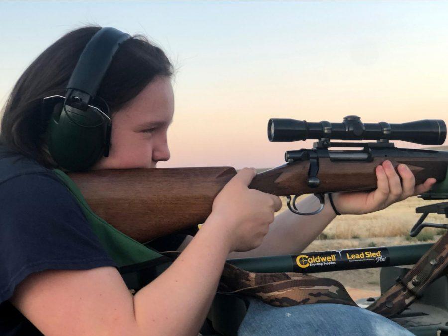 PHS Freshman Dazi Simpson looks through the scope while shooting.