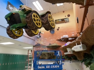Hanging in the Ag corner of the green pod, the Mars tractor is the showcase piece of the art students' latest project.