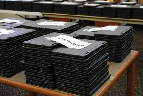 Newly arrived Chromebooks wait in the library to be checked out to PHS students