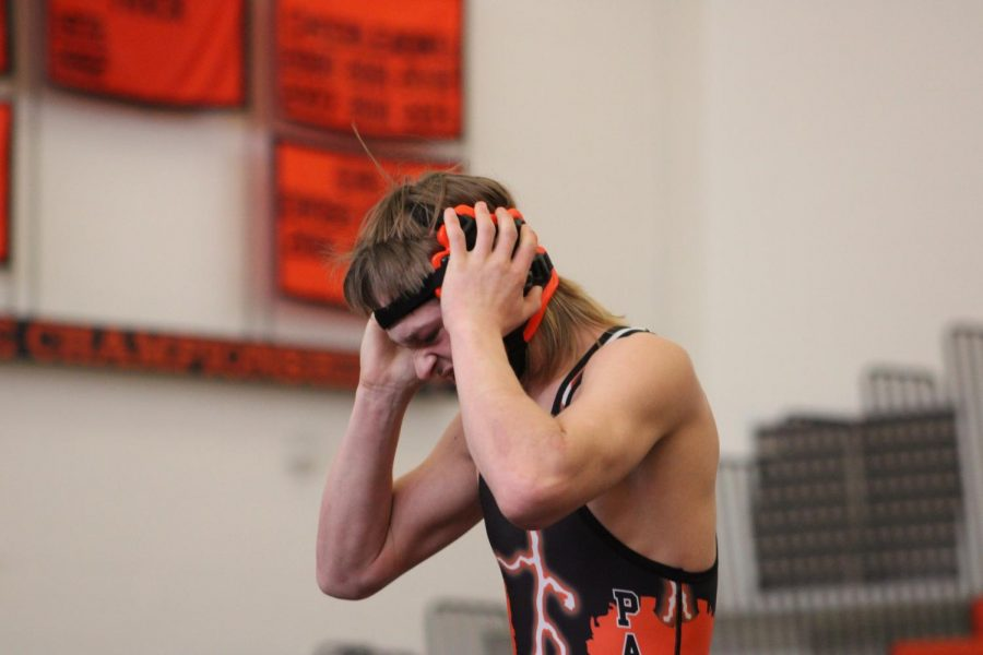 PHS sophomore wrestler Vincent Timmons prepares for his wrestling match on Friday night.