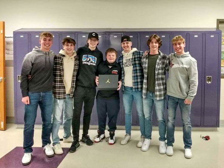 PHS Seniors Mason Marchant, Jack Pool, Landon Sessions, Noah Kiser, Kobe Ostermiller, junior Zachery Ratcliff and senior Jaden Marchant pose for a photo. In the middle, Kiser wears his newly gifted Air Jordans and holds up the shoe box.