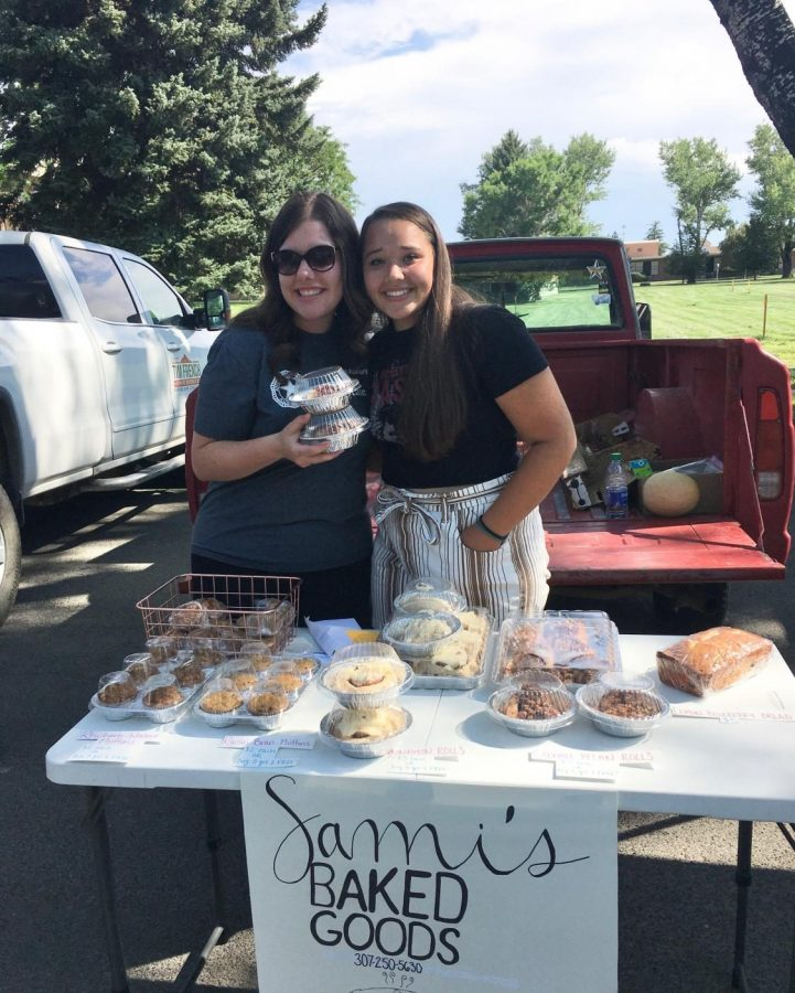 PHS graduate Danell Bransetter and senior Sami Cole selling Cole's baked goods at the local farmers market this summer.