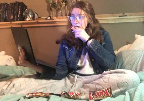Prowl copy editor and reporter Bailey Phillips demonstrates a typical day in quarantine; only dressed from the waist up and seated on a bed littered with Twix wrappers, she attends a Zoom meeting.