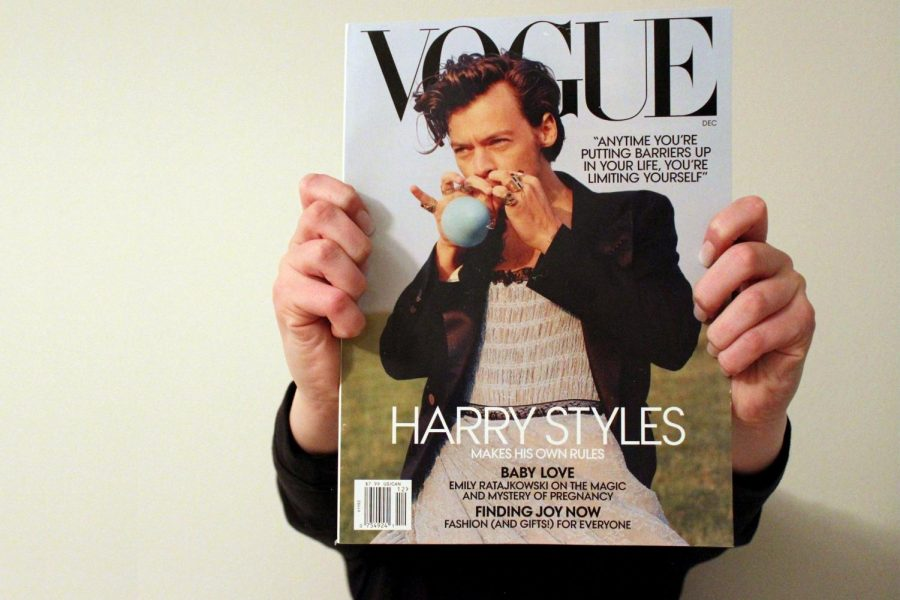Harry+Styles+on+the+cover+of+the+December+issue+of+Vogue+Magazine.+While+the+cover+made+history%2C+it+also+ignited+controversy+around+the+topic+of+what+defines+a+manly+man.