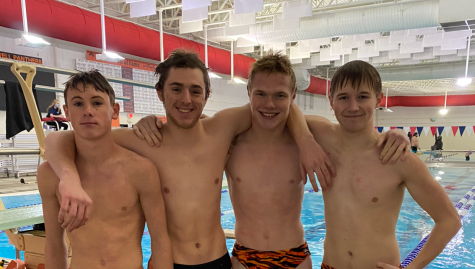 Four of Powell High School's five divers pose for a picture on Jan. 18, the day they got to come back from quarantine. (from left) Sophomore Ashtin Prentiss, junior Cole Frank, junior Caiden Gehrts and freshman Jonathan Hawley.