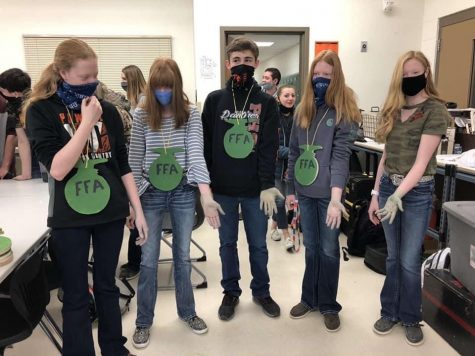 Freshman FFA members show off their green hands after participating in the Green Hand Ceremony which took place Wednesday morning, Feb. 24.