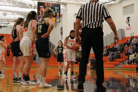 PHS junior, Kaili Wisniewski squares up to the basket for a free throw in the Powell-Cody game on Jan. 30