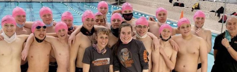 The PHS boys' swim team wears bright pink swim caps to support their head coach, Stephanie Warren, who is battling breast cancer.