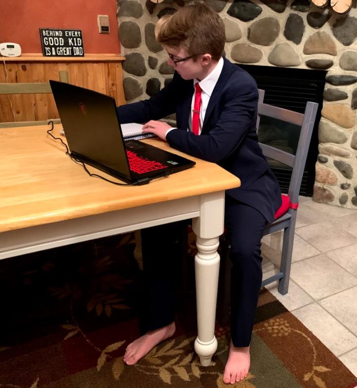 Junior Aiden Chandler prepares for a speech meet from his Powell home.