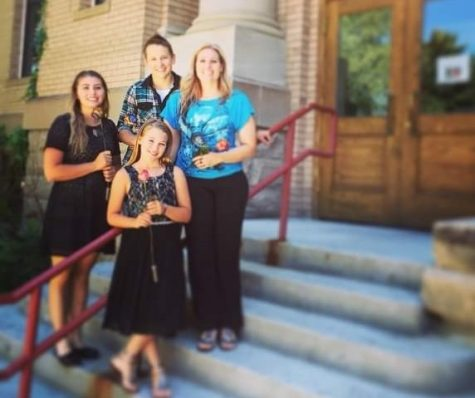 Mikayla Campbell (left), Jess Campbell (middle back), Mindy Campbel (right) and Maddie Campbell pose in front of the Park County Courthouse on April 3, 2015, the day Maddie and Mikayla officially adopted by Jess Campbell