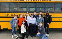 SkillsUSA members pose in front of the Panther activity bus after winning the 3A state SkillsUSA title on April 16. Chapter members include (from left): Maggie Cappiello, Olivia Lobingier, Triniti Bruski (kneeling), Jenna Merritt, Crystal Emmett, Owen Fink, Bailee Moore (kneeling) and Kalin Hicswa. Also pictured are advisers Mrs. Denise Laursen and Mr. Mike Ursuy.
