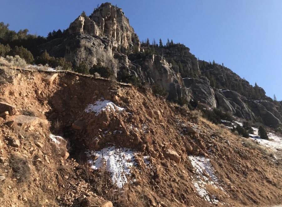 Snow melting in the Wind River Canyon on a sunny March afternoon is complemented by the brilliant blue Wyoming sky.
