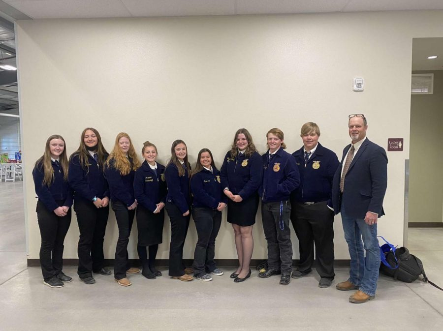 FFA members pose for a picture after competing at the state competition in Douglas on April 8. (from left) Junior Madison Harvey, freshman Shelby Carter, freshman Charlee Brence, freshman Aramonie Brinkerhoff, senior Amber Visocky, senior Tegan Lovelady, senior Stephen Dahl, junior Jace Nordeen and Adviser Mr. Bryce Meyer.