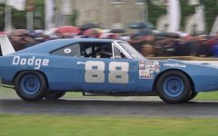 The number 88 Dodge Challenger speeds around the track at the Goodwood Festival of Speed race in 1998.