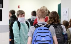 Powell High School students walk to class shortly after Principal Mr. Timothy Wormald announced that students will no longer have to abide by the previous mandated hallway traffic patterns.