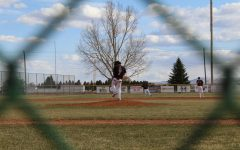Junior Kolt Flores winds up a third strike pitch against the Billings 406 Flyers April 17.
