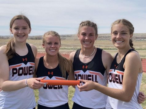 (From left) Freshman Waycee Harvey, junior Jenna Hillman, and sophomores Megan Jacobsen and Anna Bartholomew present their baton on May 1. They placed first in the 1600 Medley Relay for girls at the Lovell meet.