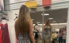 PHS junior Sarah Dunkerley is trying on her sparkly dress in the Billings Dillards for Powell's prom.