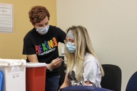 Park County Public Health nurse gives sophomore Emma Short Pfizer's COVID-19 vaccine at the vaccine clinic held at the high school on April 28.