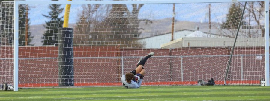 Senior Ashton Brewer dives for a kick at the goal by Cody Broncs. The Panther team improved 10-1 after their match.