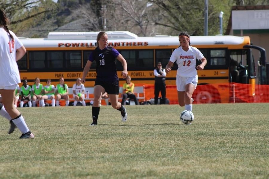 Freshman McKenzie Fields dribbles down the field to pass on May 7 against Mountain View.