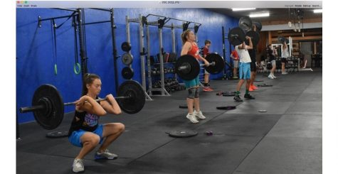 (From left) Eighth grader Saige Kidd, sophomore Maddie Campbell and eighth graders Evan Whitlock and Alex Jordan demonstrate the four stages of a squat clean.