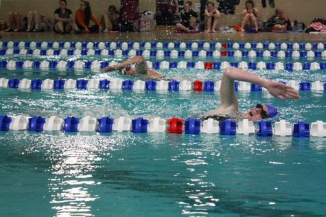 PHS Freshman Kate Miller and Makenna Tucker from Cheyenne East swim the 400 meter freestyle at the Douglas invitational.