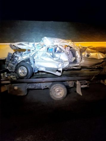 Tyler Englands mangled truck is loaded up and taken from the crash site Sep.19.