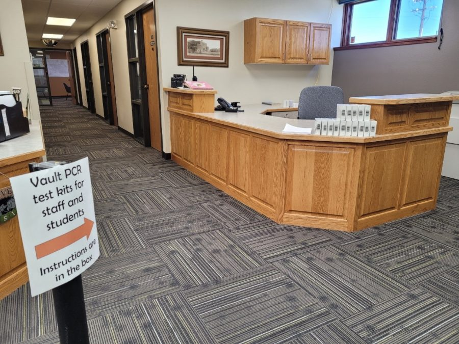 Vault PCR test kits for staff and students are lined on a desk at the Park County District #1 Administration Building.