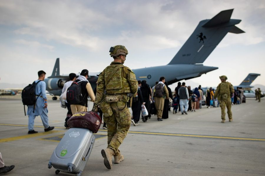 U.S. Army soldiers walking off a plane, returning home from a nine-month deployment to Afghanistan on Dec. 10, 2020.